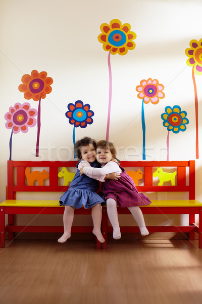Two little girls smile and hug at school Stock photo © diego_cervo