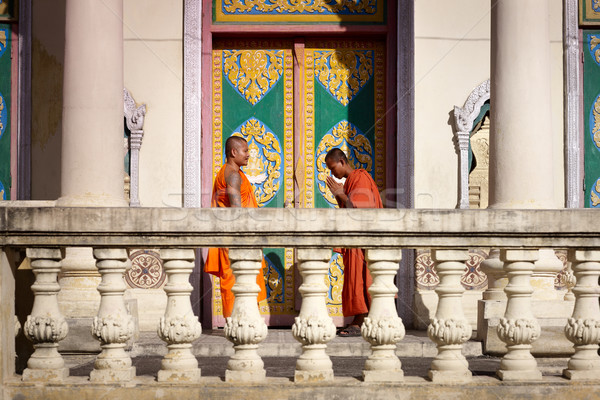 Two young monks meet and salute in buddhist pagoda, Asia Stock photo © diego_cervo