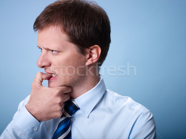 nervous business man biting finger nails  Stock photo © diego_cervo