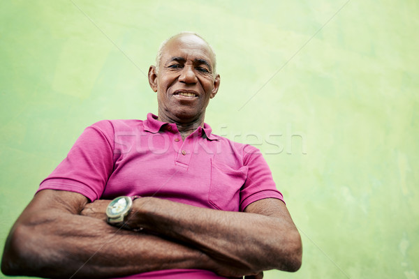 Portrait of elderly black man looking and smiling at camera Stock photo © diego_cervo