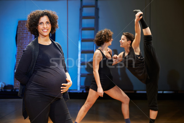 Pregnant woman teaching dance to students in theatre Stock photo © diego_cervo