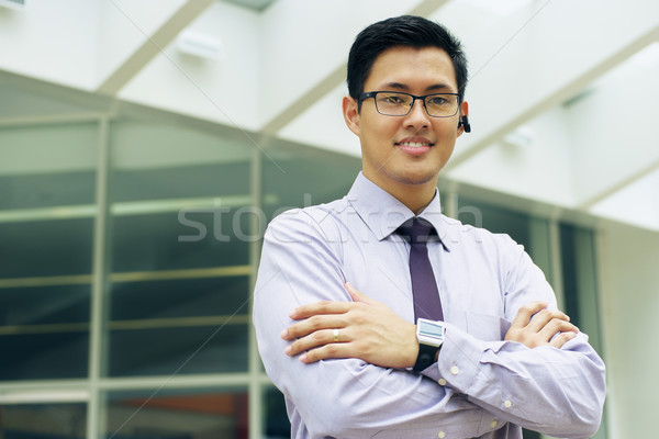 Business Man With Smartwatch And Bluetooth Handsfree Device Stock photo © diego_cervo
