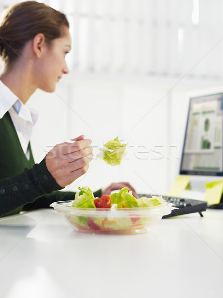 businesswoman eating salad Stock photo © diego_cervo