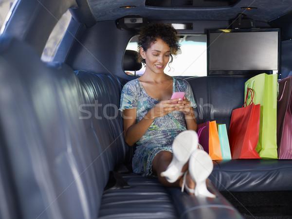 Nő limuzin vásárlás ül bevásárlótáskák gépel Stock fotó © diego_cervo