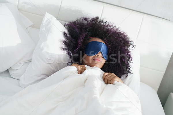 Tired Black Girl Waking Up In Bed With Sleep Mask Stock photo © diego_cervo