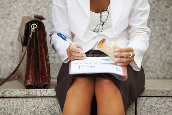 businesswoman eating sandwich  Stock photo © diego_cervo