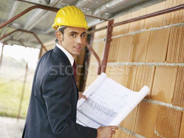 Stockfoto: Architect · bouwplaats · kaukasisch · mannelijke · blauwdrukken