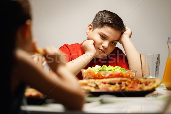 Mother Giving Salad Instead Of Pizza To Overweight Son Stock photo © diego_cervo