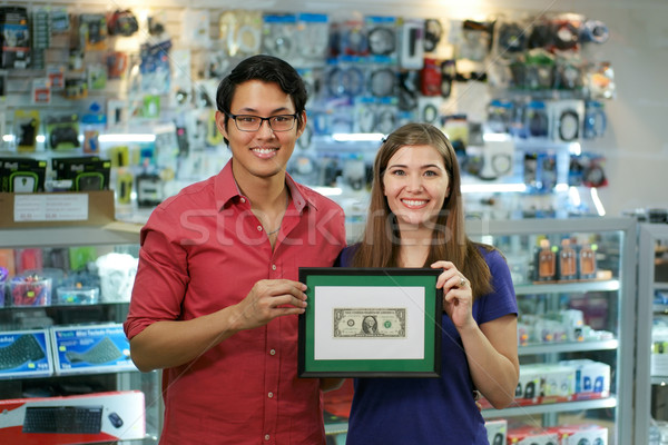Portrait Of Happy Shop Owners Showing First Dollar Earning Stock photo © diego_cervo