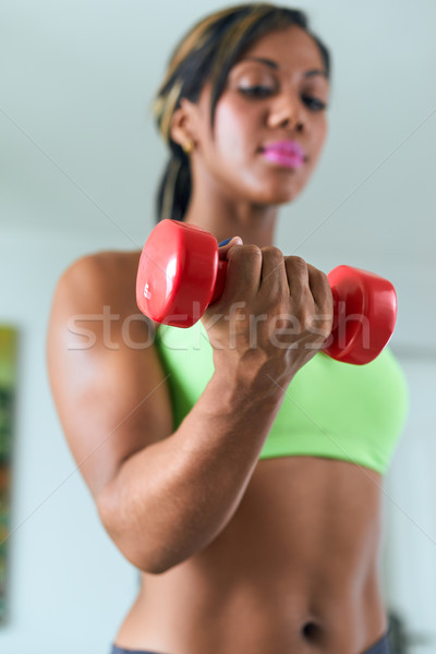 Home Fitness Black Woman Training Biceps With Weights Stock photo © diego_cervo