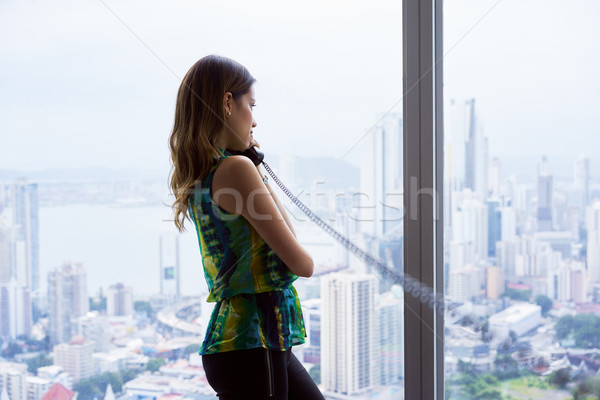 Mulher falante telefone escritório olhando fora Foto stock © diego_cervo