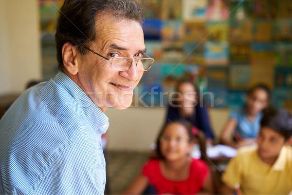 Amichevole insegnante classe felice professore sorridere Foto d'archivio © diego_cervo