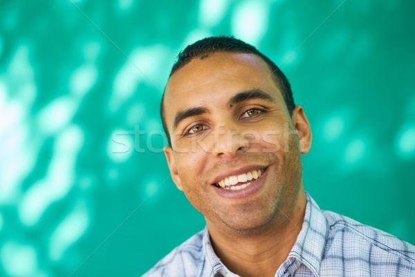 Mensen portret jonge man glimlachend blij gezicht Stockfoto © diego_cervo
