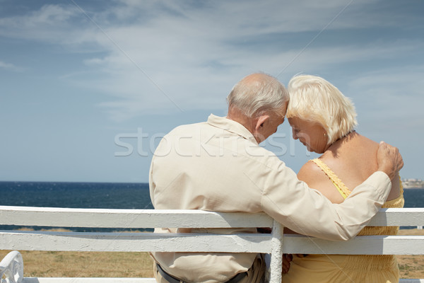 old man and woman on bench at the sea Stock photo © diego_cervo