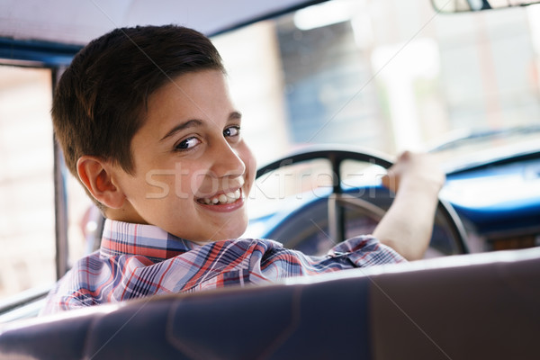 Portrait Child Taking Driving Lesson In Old Car Smiling Stock photo © diego_cervo