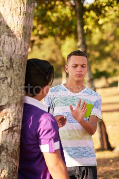Tieners roken sigaret jongen rook jeugdcultuur Stockfoto © diego_cervo