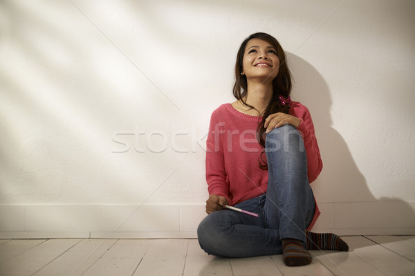 Happy Asian girl holding pregnancy test at home Stock photo © diego_cervo