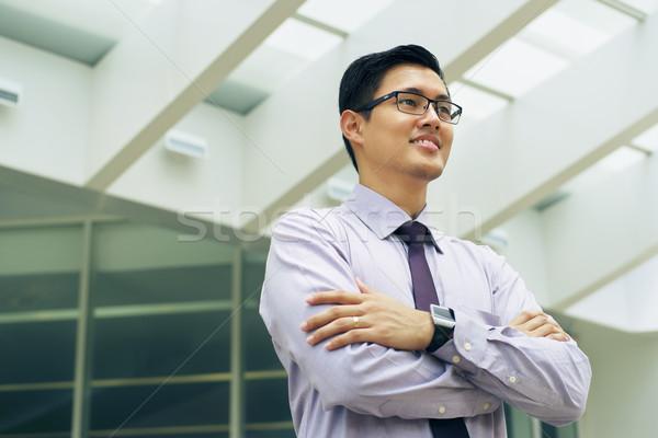 Portrait Chinese Businessman Contemplating Office Skyscraper Stock photo © diego_cervo