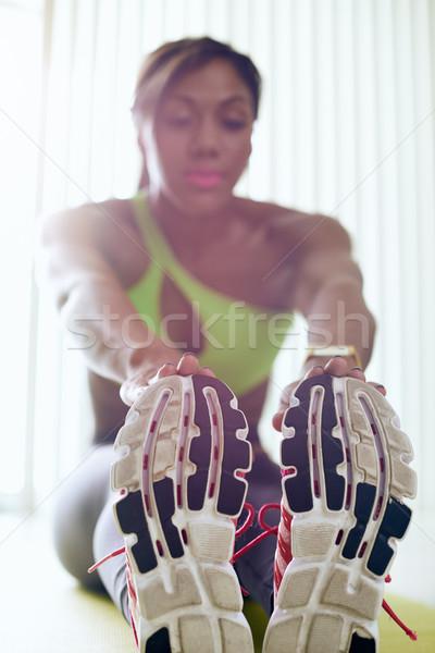 Otthon fitnessz afroamerikai nő lábak nyújtás fiatal felnőtt Stock fotó © diego_cervo