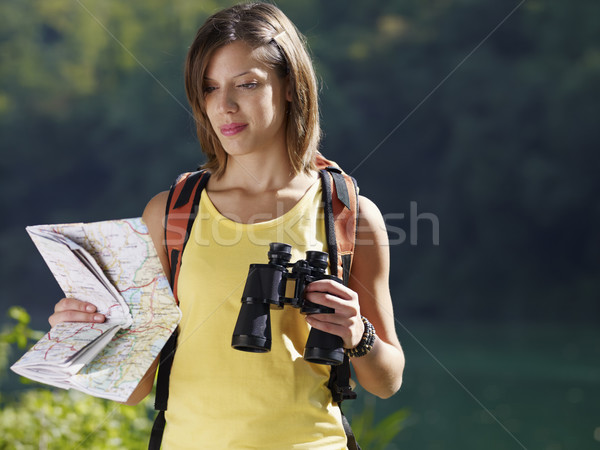 woman hiking with binoculars and map Stock photo © diego_cervo