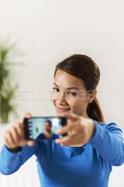 asian girl sharing pictureon social network Stock photo © diego_cervo