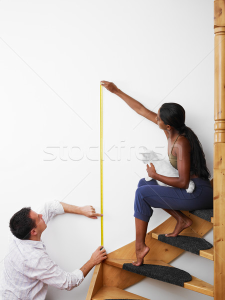 Stock photo: man and woman doing diy work at home