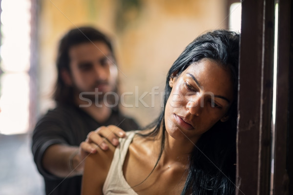 domestic violence with young man and abused woman Stock photo © diego_cervo