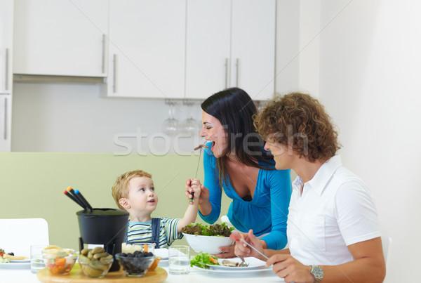 Famille manger viande famille heureuse maison espace de copie Photo stock © diego_cervo