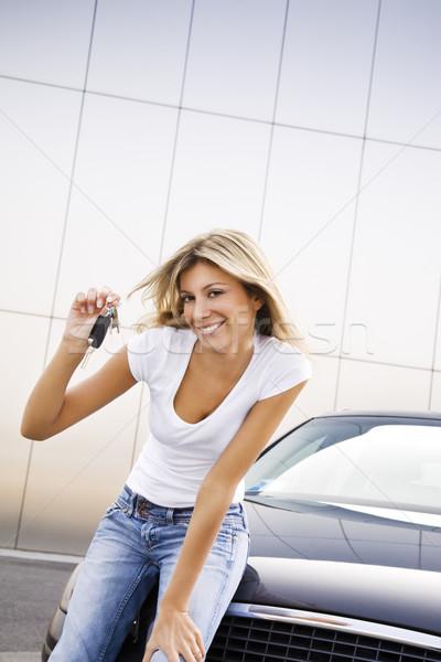 Yeni araç genç kadın tuşları kadın araba Stok fotoğraf © diego_cervo