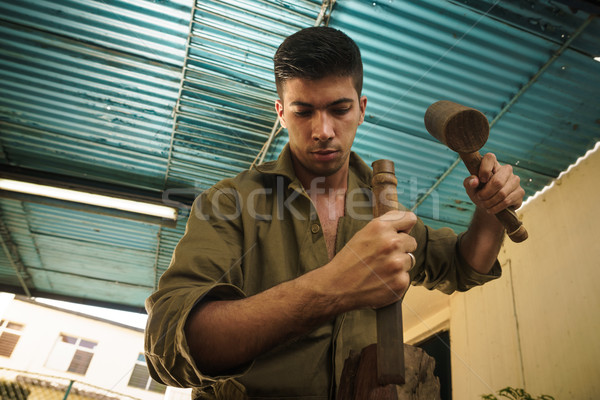 Young Sculptor Artist Working And Sculpting Wood Statue-4 Stock photo © diego_cervo