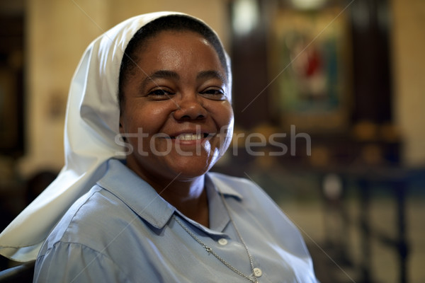 Woman and spirituality, portrait of catholic nun praying in chur Stock photo © diego_cervo