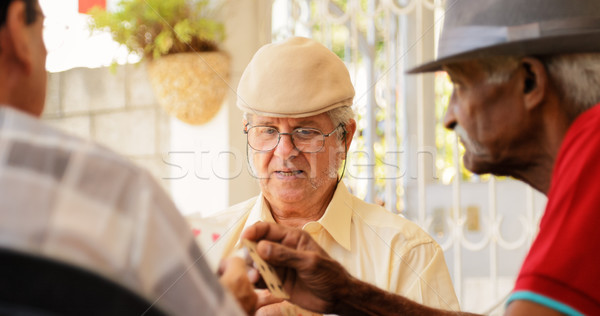 Group Of Senior Men Playing Cards Game Stock photo © diego_cervo