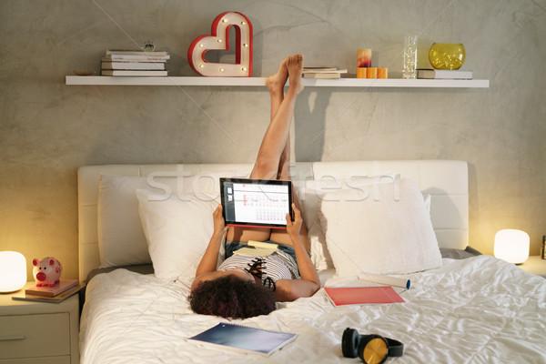 女性 勉強 ベッド 宿題 日没 アフリカ系アメリカ人 ストックフォト © diego_cervo