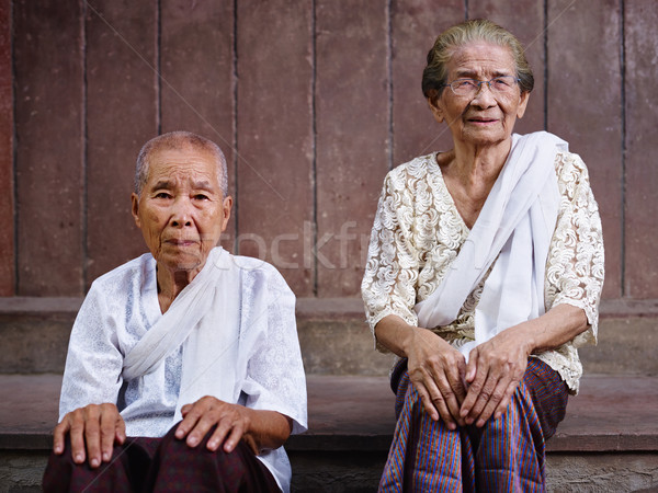 Portrait of two senior asian women looking at camera Stock photo © diego_cervo