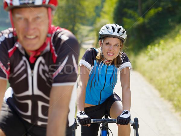 Senior fietser man jonge vrouw weg fiets Stockfoto © diego_cervo