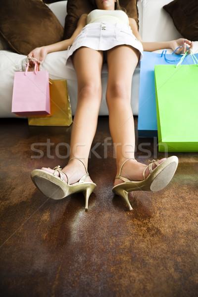 Vásárlás nő megnyugtató kanapé hosszú nap Stock fotó © diego_cervo