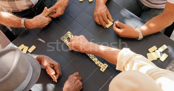 Idős emberek öreg férfiak játszik dominó Stock fotó © diego_cervo
