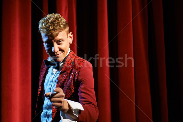 Portrait of anchorman at show against red curtain Stock photo © diego_cervo