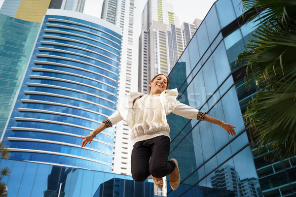 latina business woman jumping joy happy office smile Stock photo © diego_cervo