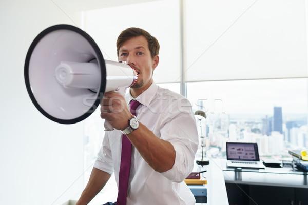 Homem de negócios megafone anúncio escritório jovem executivo Foto stock © diego_cervo