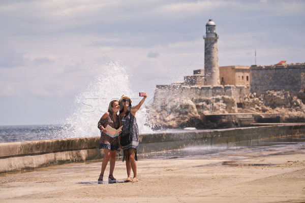 Turist kızlar cep telefonu Havana Küba Stok fotoğraf © diego_cervo