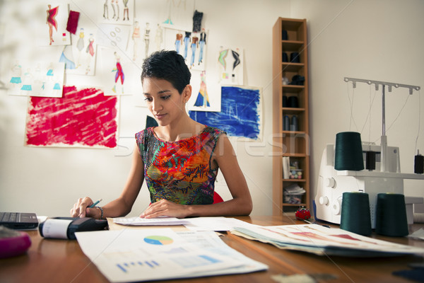 hispanic woman doing budget in fashion designer atelier Stock photo © diego_cervo