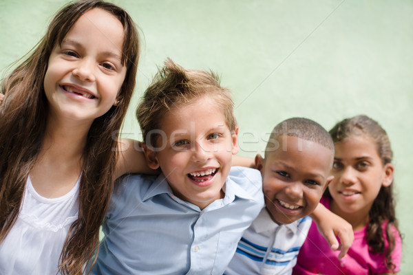 happy children hugging, smiling and having fun Stock photo © diego_cervo