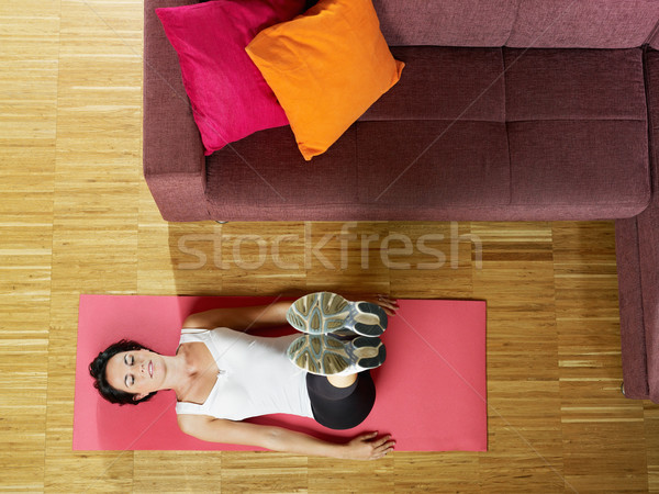 woman doing abs exercise at home Stock photo © diego_cervo