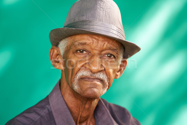 People Portrait Serious Elderly African American Man With Hat Stock photo © diego_cervo