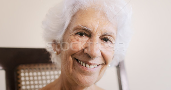 Idős nő öreg hölgy megnyugtató hintaszék otthon portré Stock fotó © diego_cervo