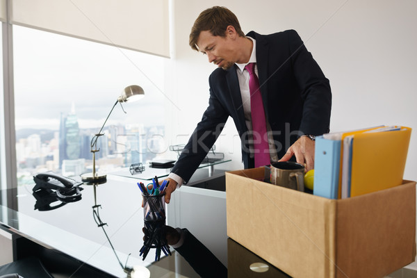 Just Hired Business Man In New Office Putting Desk In Order Stock photo © diego_cervo