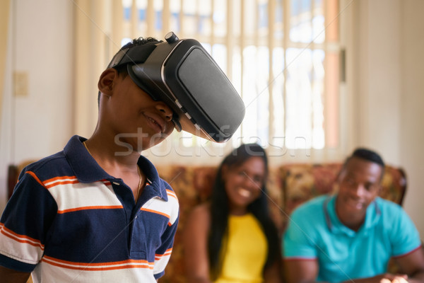 Fun For Happy Family Playing Virtual Reality Goggles VR Glasses Stock photo © diego_cervo