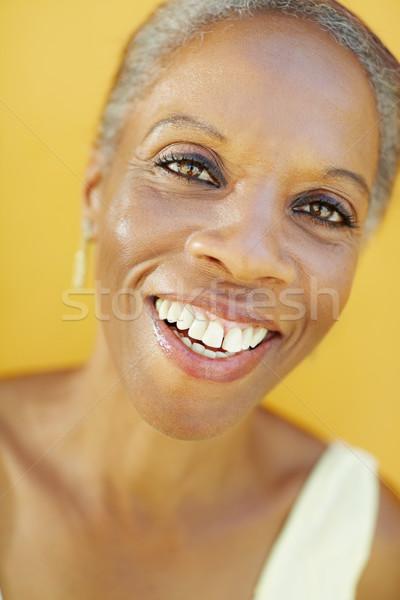 зрелый африканских женщина улыбается радости портрет 50 лет Сток-фото © diego_cervo