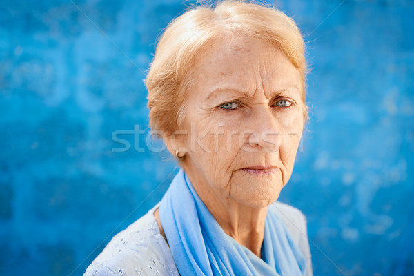 sad old blond woman looking at camera Stock photo © diego_cervo